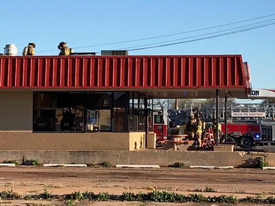 Abilene firefighters are on the roof and inside a Dairy Queen at  942 N. Mockingbird Lane on Wednesday, March 13, 2019, after an overheated fryer caused heavy smoke.