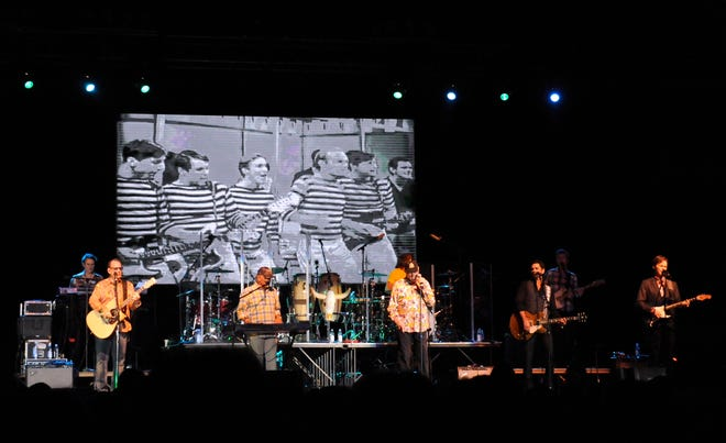 The Beach Boys perform Sunday night at the Taylor County Expo Center on March 6, 2016. Behind them is projected a television performance of the band from the 1960s. The group, with co-founder Mike Love and longtime member Bruce Johnston, return to Abilene next week.
