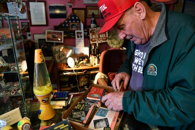 Fred Schwake looks through a collection of World War II-era paperbacks published by the Armed Services Editions, March 9, 2019. Schwake owns One of a Kind Unique Antiques in Ballinger, he found the rare books at an estate sale.
