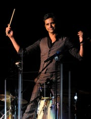 Ronald W. Erdrich/Reporter-NewsActor John Stamos stands above a drum set Sunday night March 6, 2016 during the Beach Boys concert at the Taylor County Expo Center. Stamos played drums and guitar with the band.