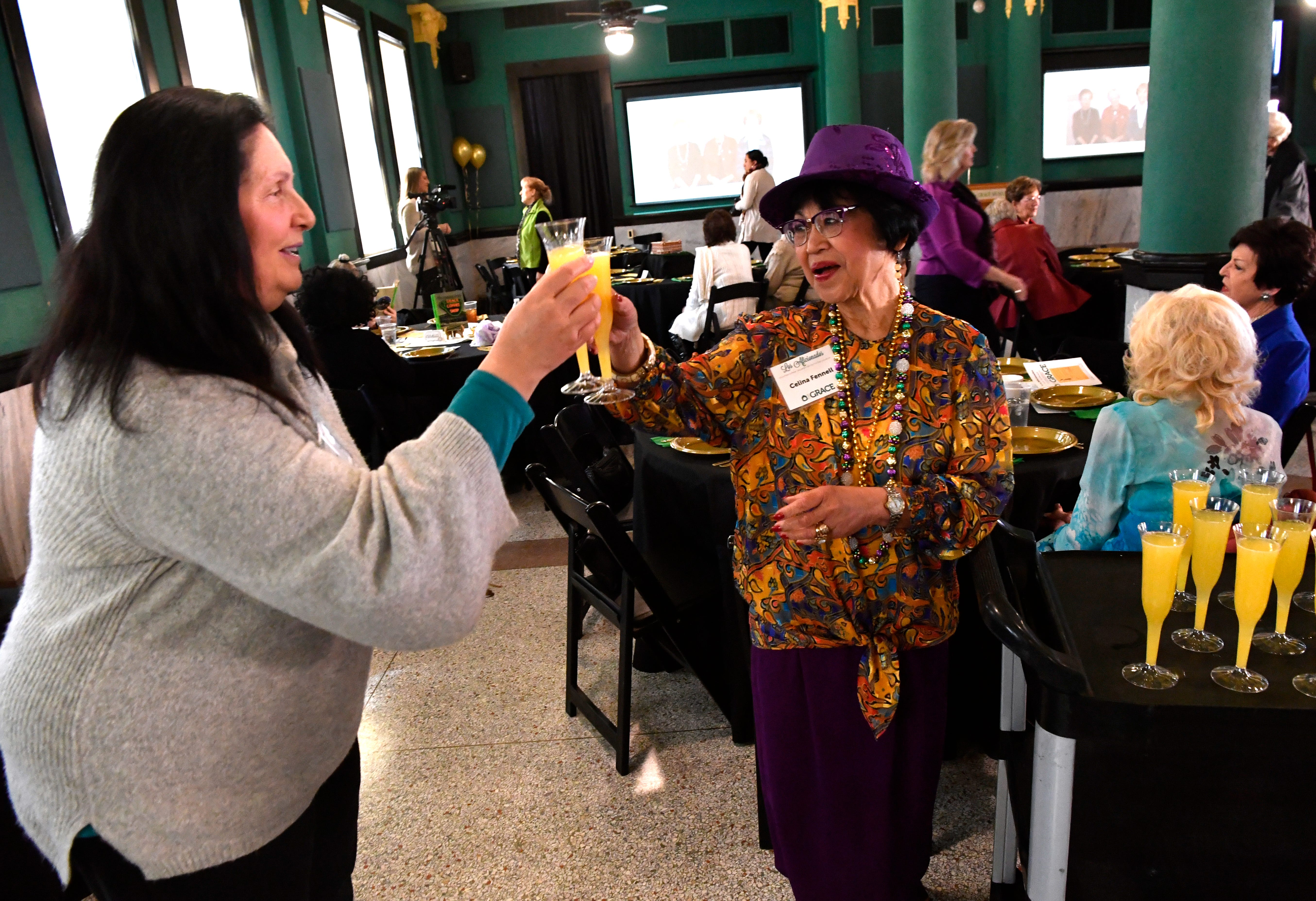 Ita Vaiser and Celina Fennell celebrate 50 years of Los Aficionados by toasting with mimosas at the group's monthly meeting March 5. The volunteer group has been promoting the arts in Abilene since 1969.