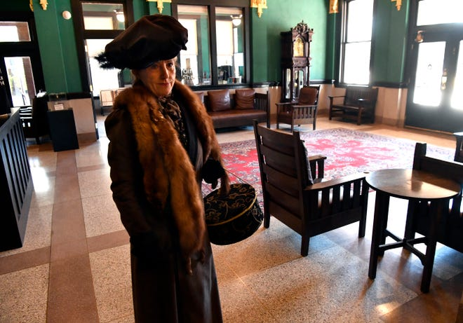 Judy Godfrey, dressed as Grace Beckham in the early 20th century, stands in the lobby of the Grace Museum on March 5. Godfrey was presenting a program for Los Aficionados on Beckham's life, the inspiration for the name of the hotel that later became the museum.