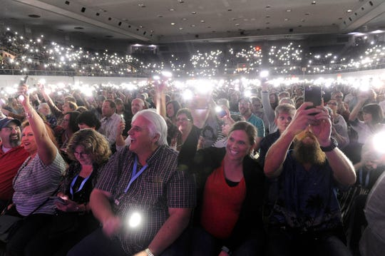 Ronald W. Erdrich/Reporter-NewsAudience members activate the flashlights on their smartphones and hold them overhead during Sunday's Beach Boys concert at the Taylor County Expo Center March 6, 2016.