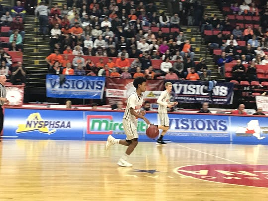 Marathon's La'Zhay Reinford dribbles up court during Sunday's Class D state quarterfinal against Bridgehampton at Floyd L. Maines Veterans Memorial Arena. Marathon won, 66-60 to advance to its first final four.