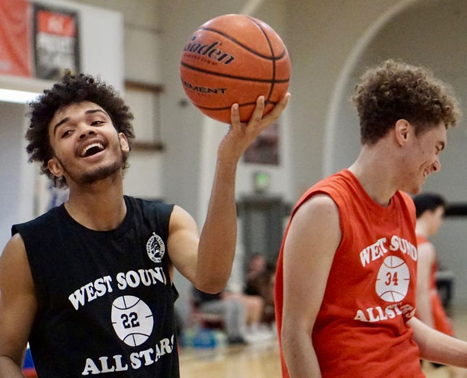 South Kitsap's DeAnte Ward (left) and Olympic's Caleb Morgan share a laugh during Tuesday's West Sound Senior High School All-Star Basketball Games at Olympic College.
