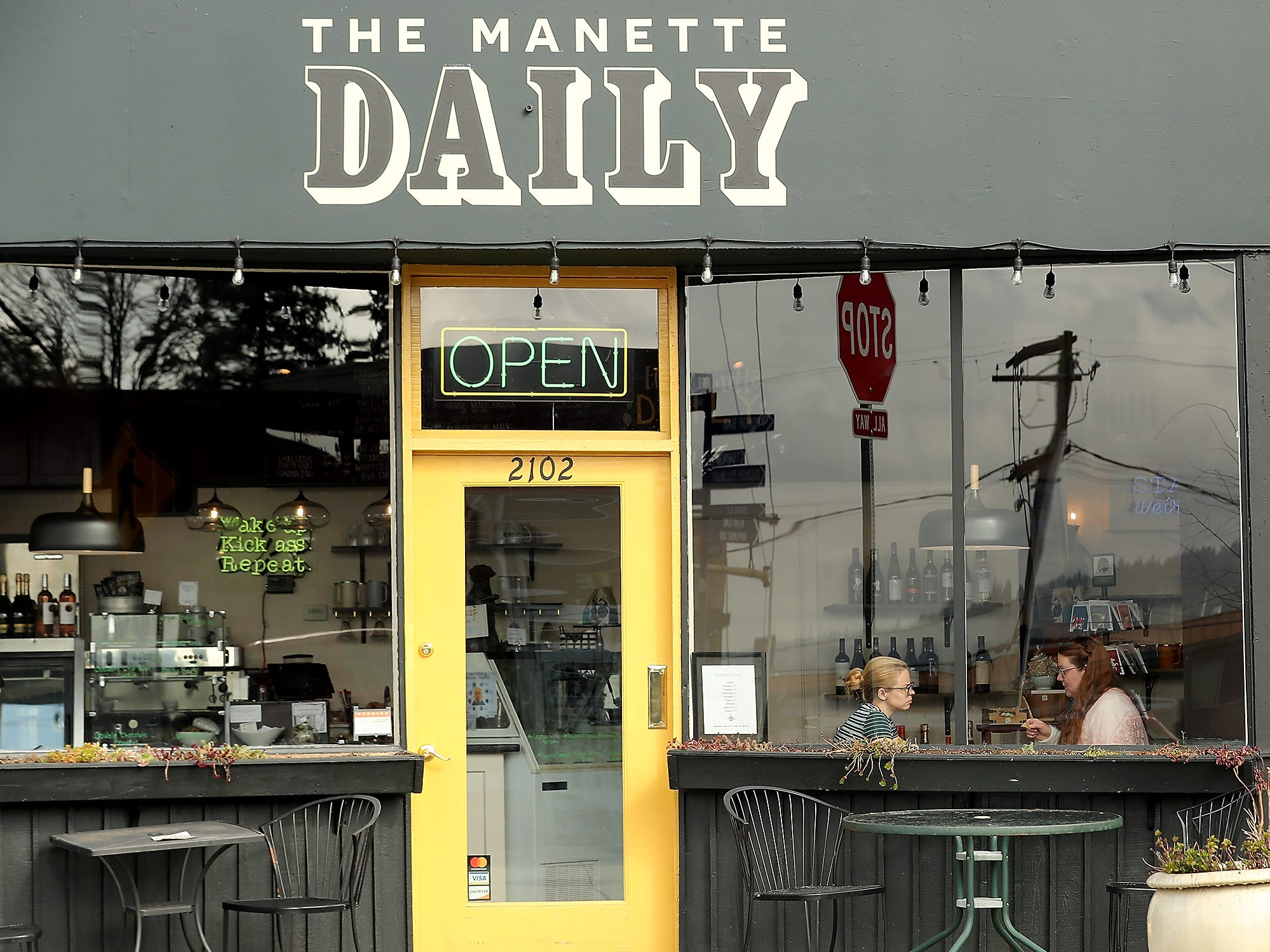 Karen Sawyer-Meehan and Katie Albright are framed in the front window as they enjoy their lunch at The Manette Daily in Bremerton on Wednesday, March 13, 2019.
