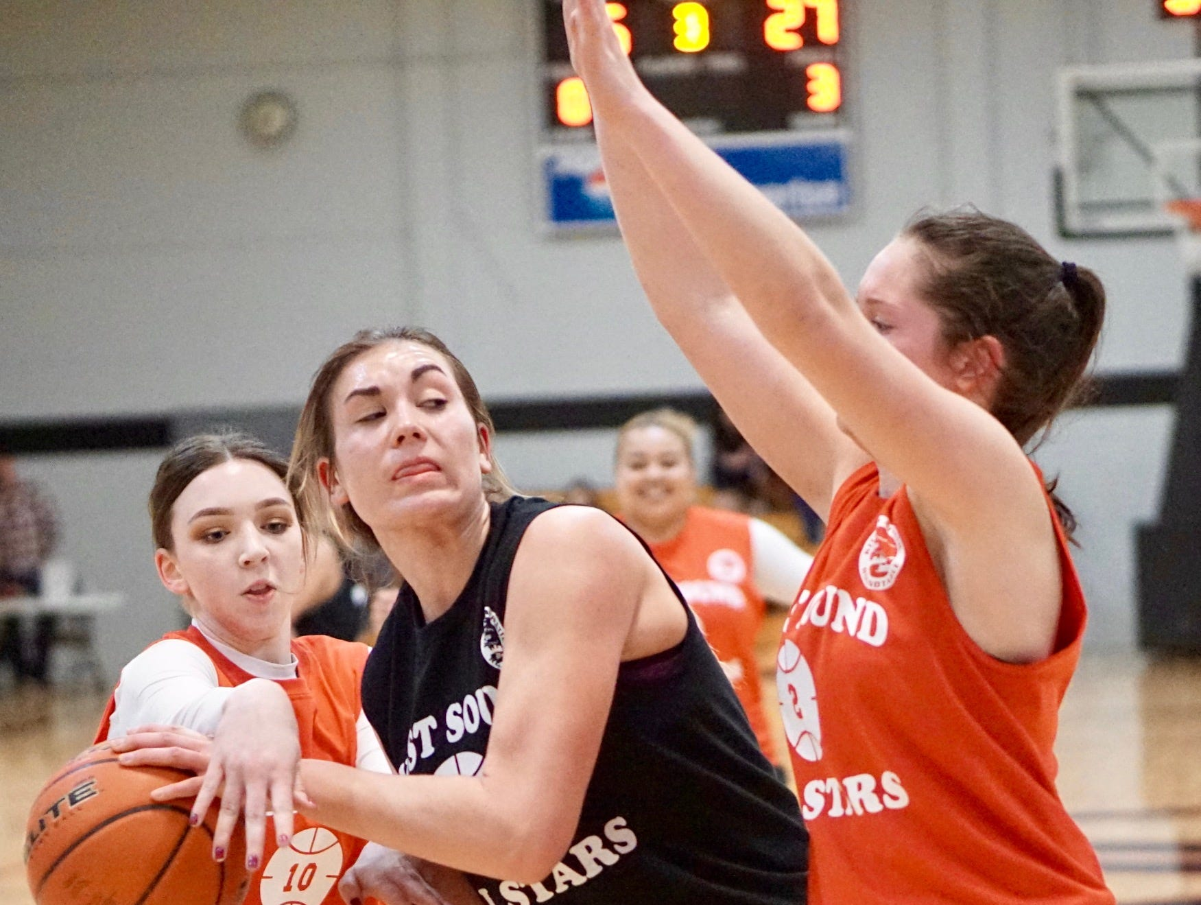 North Kitsap's Maddie Purden tries to make a pass during Tuesday's West Sound Senior High School All-Star Basketball Games at Olympic College.