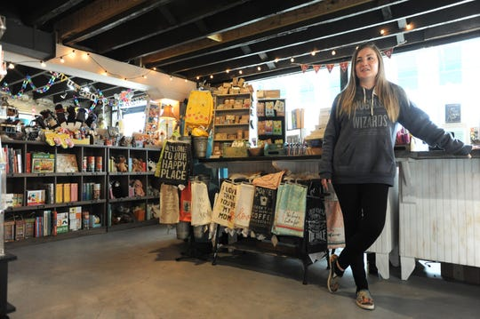 Sassafras on Sutton manager Kathleen Madden is one of seven employees of the bookstore to return to work recently after a December roof collapse caused the business to close for nearly three months.