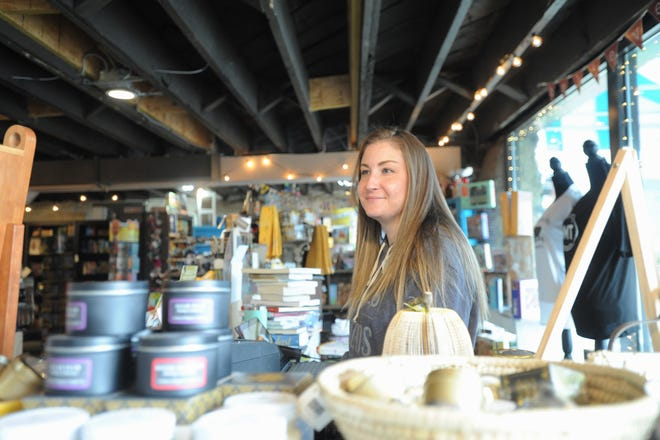 Kathleen Madden, manager of Sassafras on Sutton, greets customers on March 13.