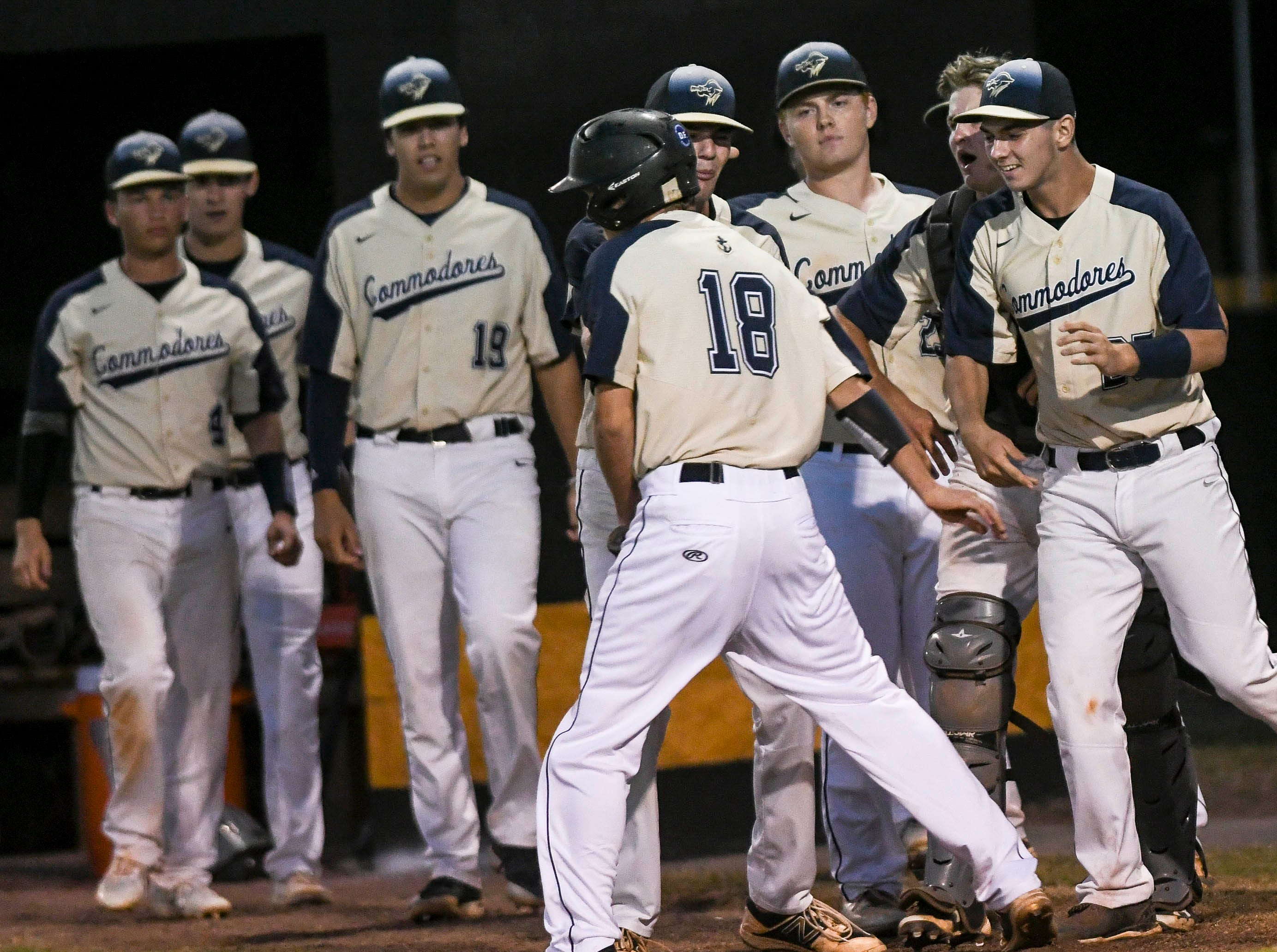 Eau Gallie's Michael O'Keefe celebrates with his teammates during Tuesday's game in Merritt Island