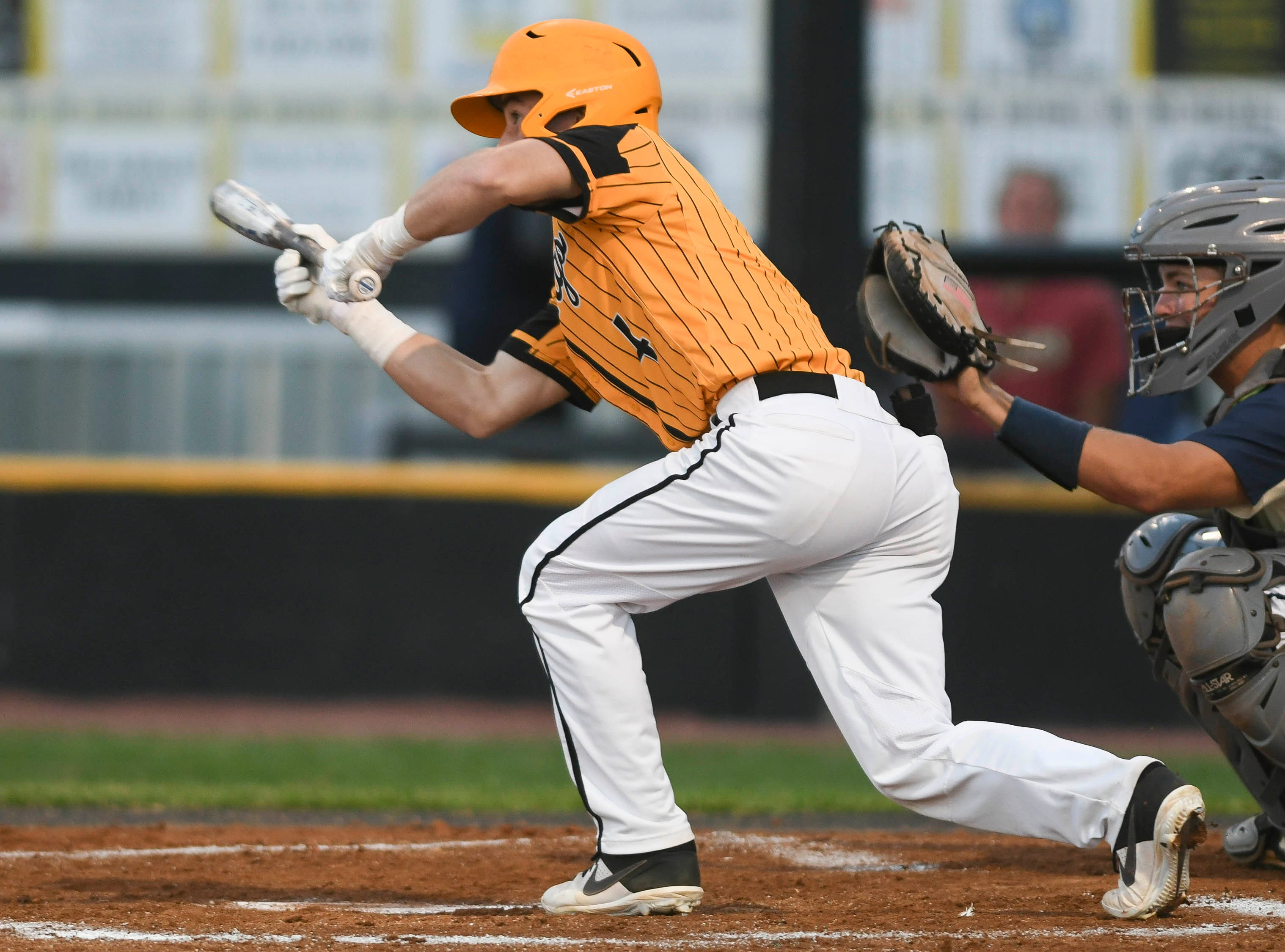 Ryan Taylor of Merritt Island attempts a bunt during Tuesday's game against Eau Gallie.