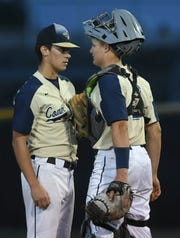 Eau Gallie pitcher Trey Jackson and catcher Sean Williams have a conference on the mound during Tuesday's game in Merritt Island