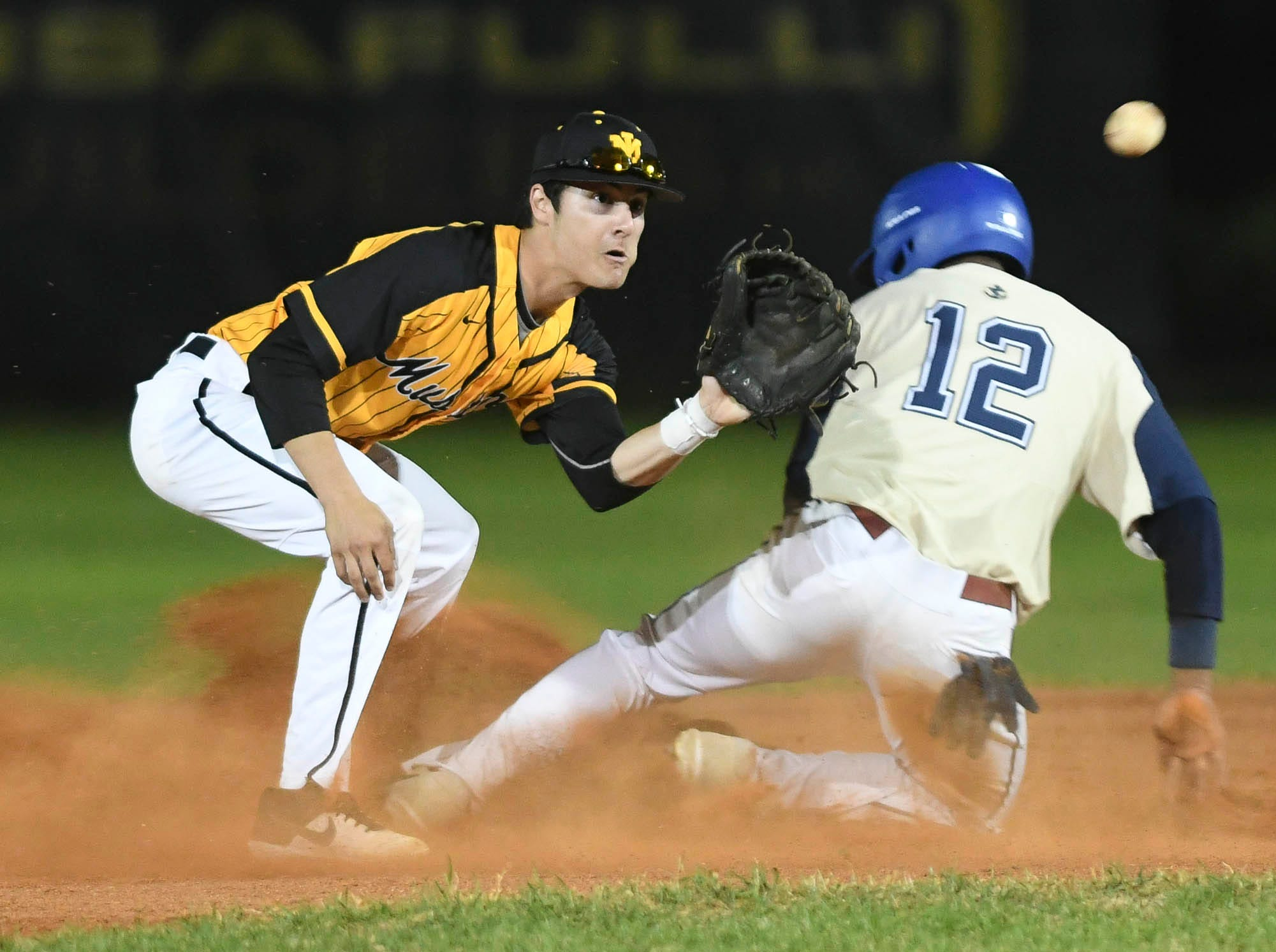 The ball arrives too late for Merritt Island's Kyle  Jackson to tag out DeAmez Ross of Eau Gallie during Tuesday's game in Merritt Island