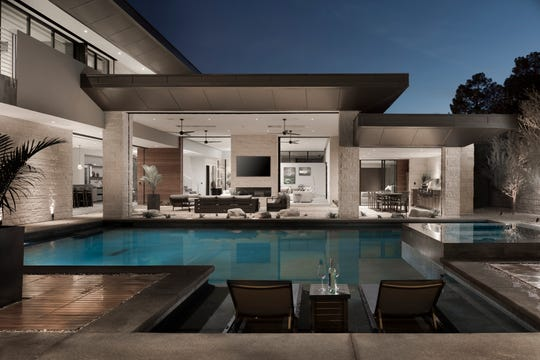 Glass panels in the New American Home model slide open to blend indoor and outdoor entertaining spaces.