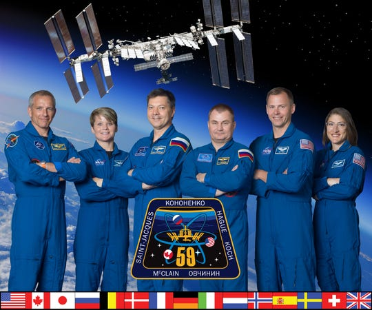 Official Expedition 59 Crew Portrait - 57S crew: Oleg Konenenko, David Saint-Jacques, Anne McClain. 58S crew: Oleg Shkripochka and Christina Koch.  Photo Date: June 28, 2018.  Location: Building 8, Room 183 - Photo Studio.  Photographer: Robert Markowitz