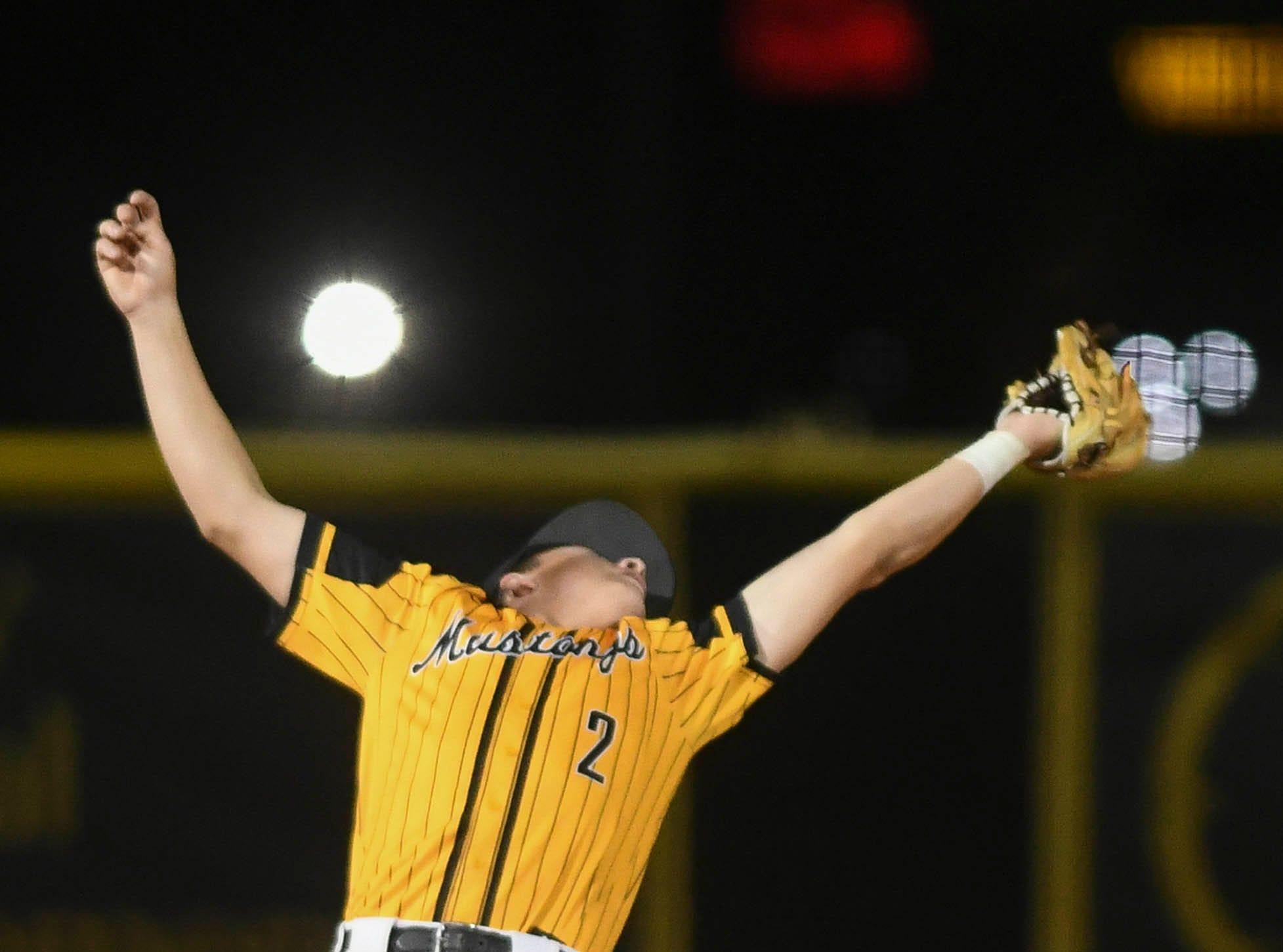 Anthony Cartagena of Merritt Island tracks down a fly balll during Tuesday's game against Eau Gallie.