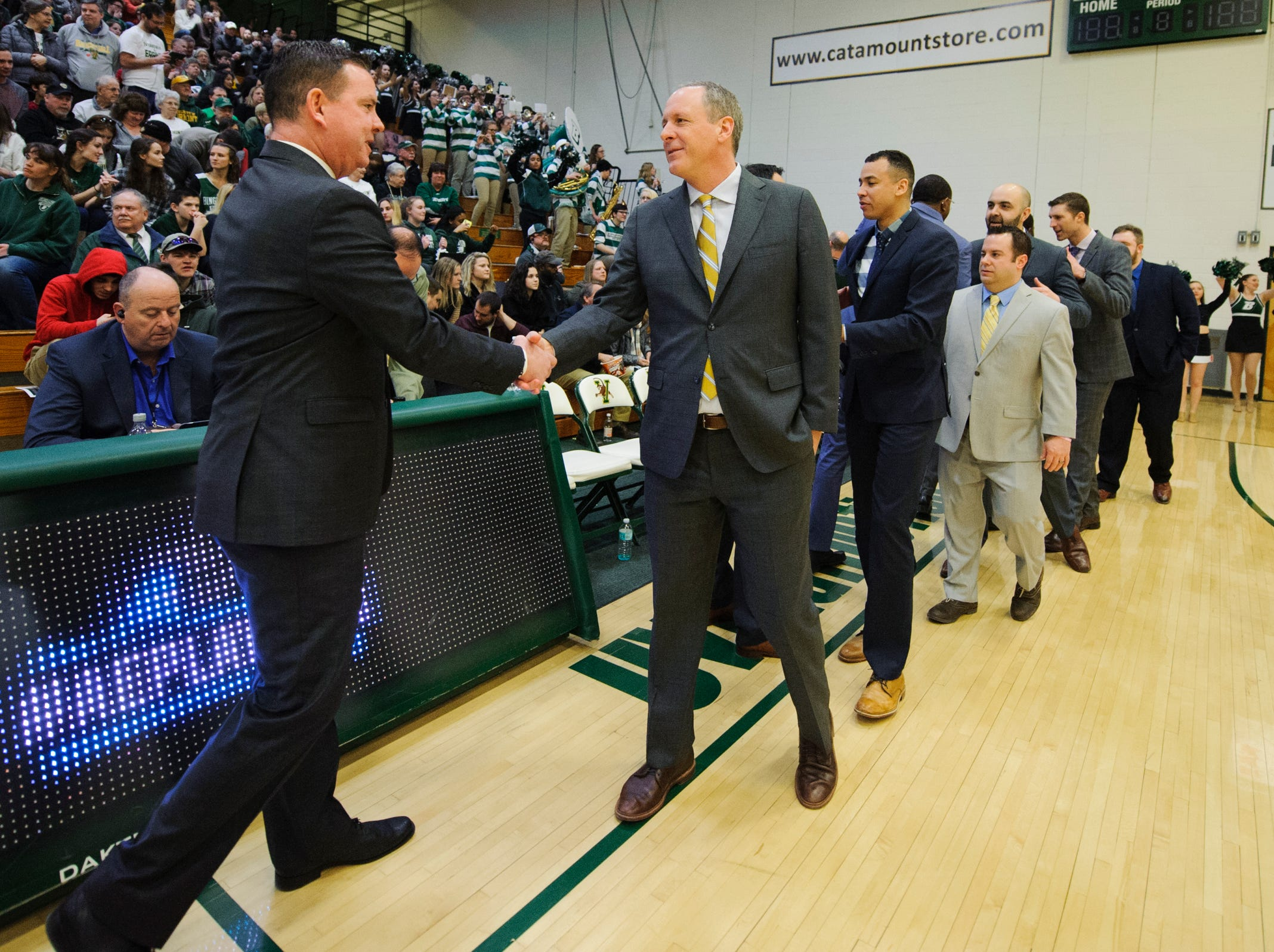 Coaches shake before the America East semifinal game between the Binghamton Bearcats and the Vermont Catamounts at Patrick Gym on Tuesday March 12, 2019 in Burlington, Vermont.