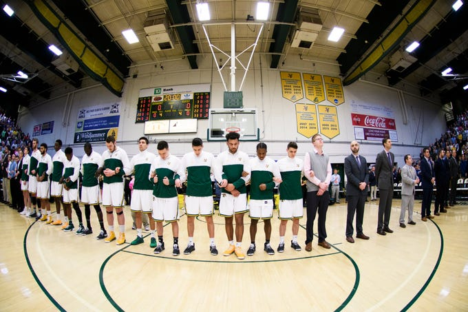 Vermont listens to the National Anthem during the America East semifinal game between the Binghamton Bearcats and the Vermont Catamounts at Patrick Gym on Tuesday March 12, 2019 in Burlington, Vermont.