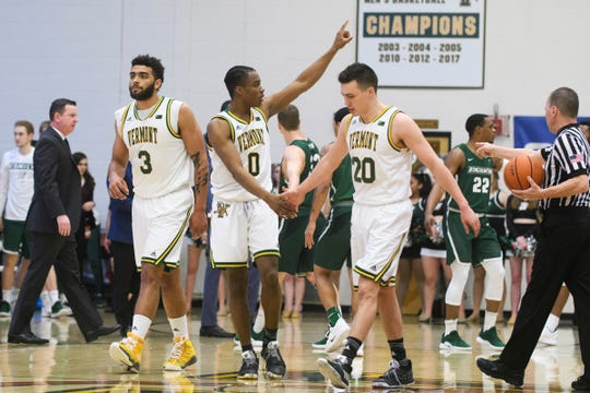 Vermont guard Stef Smith (0) celebrates a three pointer with Vermont guard Ernie Duncan (20) during the America East semifinal game between the Binghamton Bearcats and the Vermont Catamounts at Patrick Gym on Tuesday March 12, 2019 in Burlington, Vermont.