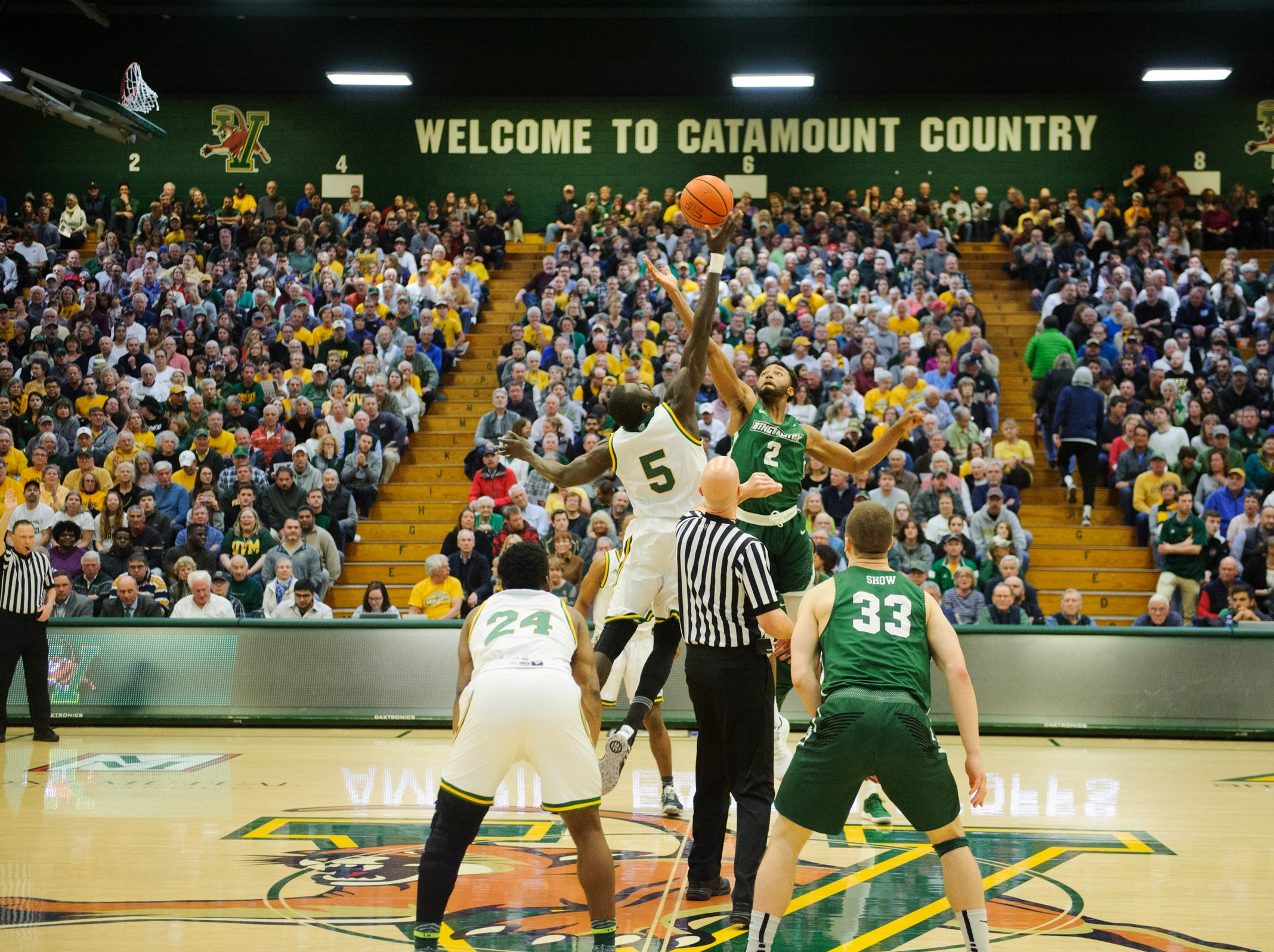 The opening tip-off  for the America East semifinal game between the Binghamton Bearcats and the Vermont Catamounts at Patrick Gym on Tuesday March 12, 2019 in Burlington, Vermont.