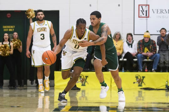 Vermont guard Stef Smith (0) dribbles the ball down the court during the America East semifinal game between the Binghamton Bearcats and the Vermont Catamounts at Patrick Gym on Tuesday March 12, 2019 in Burlington, Vermont.