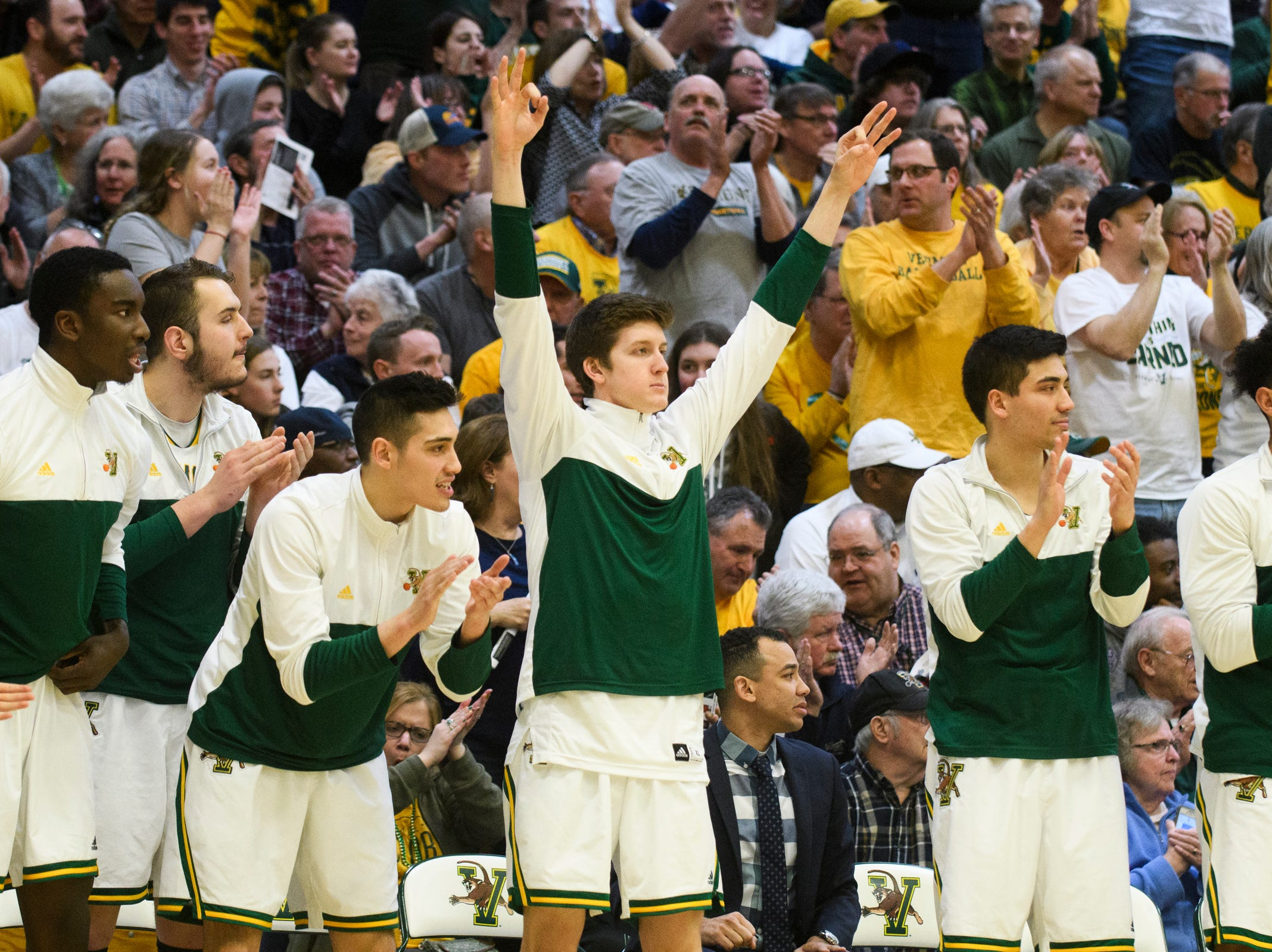 The Vermont bench celebrates a three pointer during the America East semifinal game between the Binghamton Bearcats and the Vermont Catamounts at Patrick Gym on Tuesday March 12, 2019 in Burlington, Vermont.