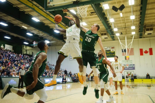 Vermont sophomore Ra Kpedi goes up for a layup during the America East semifinal game between the Binghamton Bearcats and the Vermont Catamounts at Patrick Gym on Tuesday March 12, 2019 in Burlington, Vermont.