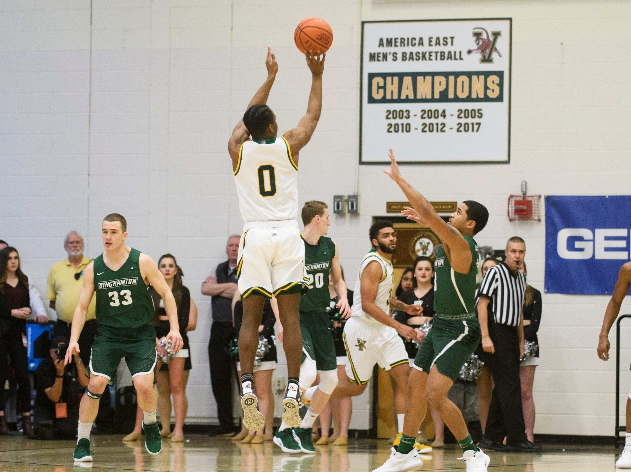 Vermont guard Stef Smith (0) shoots a three pointer during the America East semifinal game between the Binghamton Bearcats and the Vermont Catamounts at Patrick Gym on Tuesday March 12, 2019 in Burlington, Vermont.
