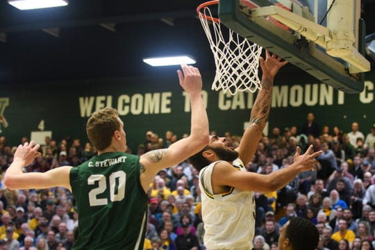 Vermont forward Anthony Lamb (3) leaps for a lay up during the America East semifinal game between the Binghamton Bearcats and the Vermont Catamounts at Patrick Gym on Tuesday March 12, 2019 in Burlington, Vermont.