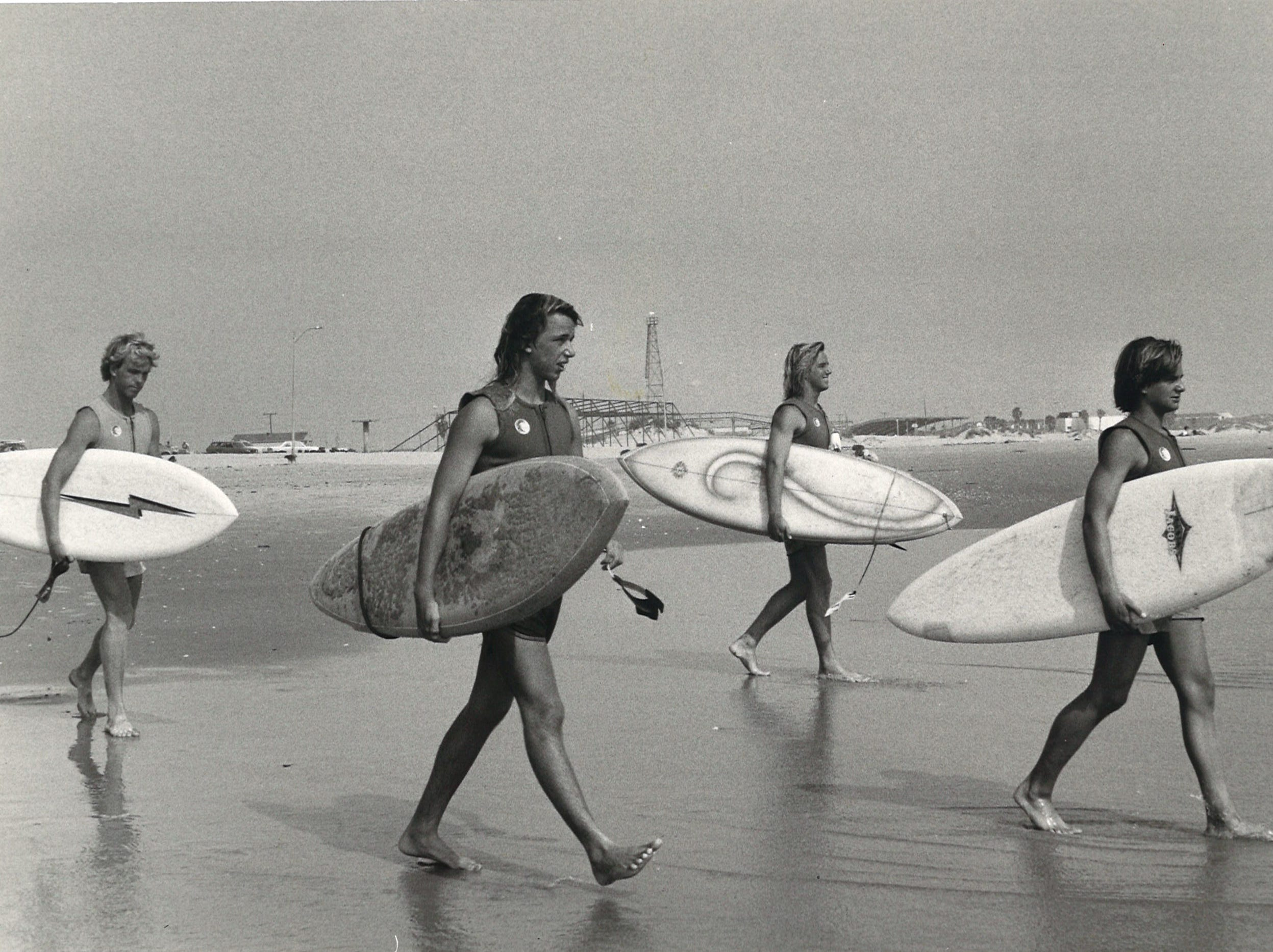 Heading into the surf during the 1979 U.S. Surfing Championship, which as held in Corpus Christi that year.