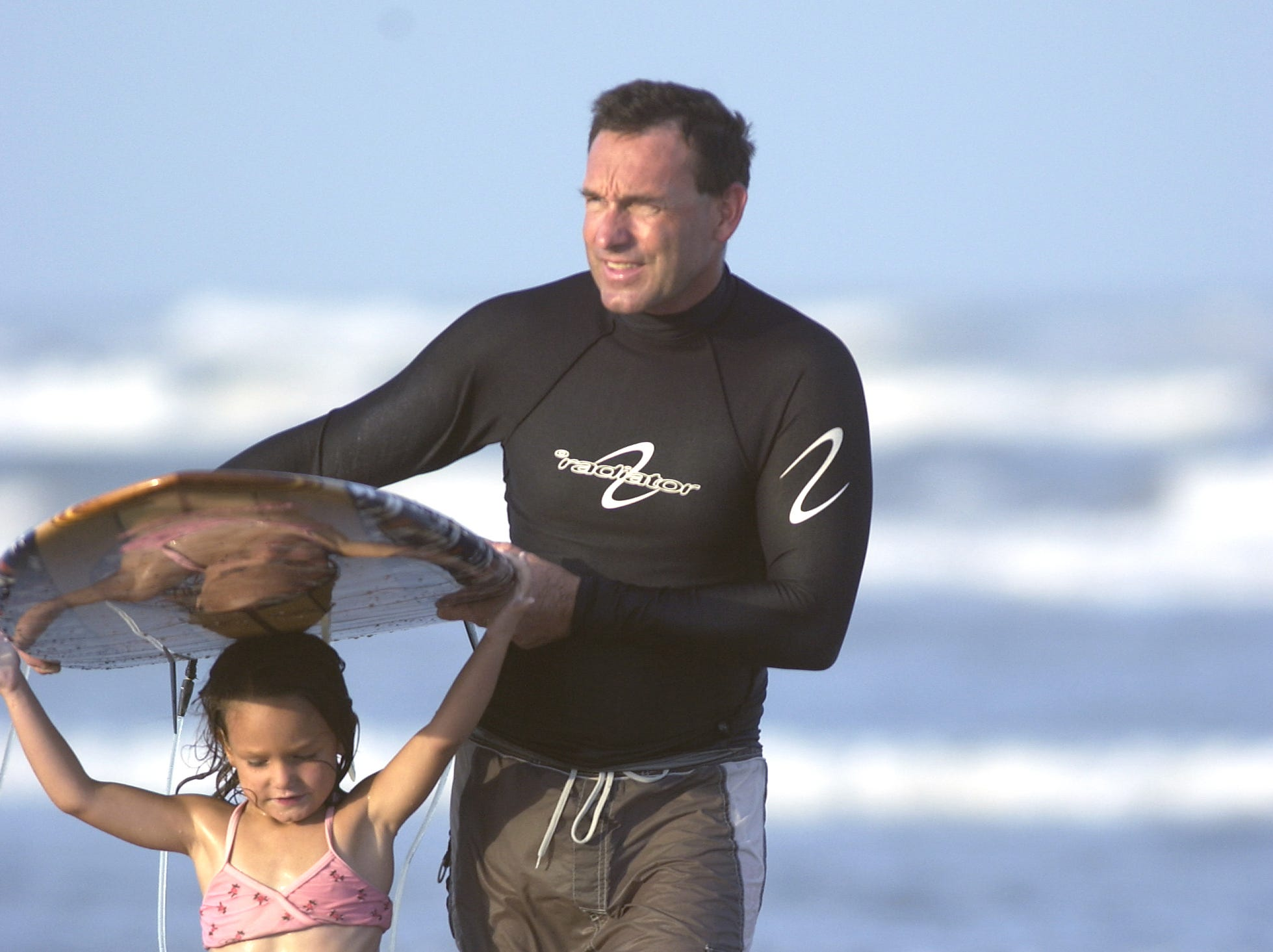 Natasha Maley, 5, learn to surf at Padre Island from her father, Michael Maley on June 13, 2003.