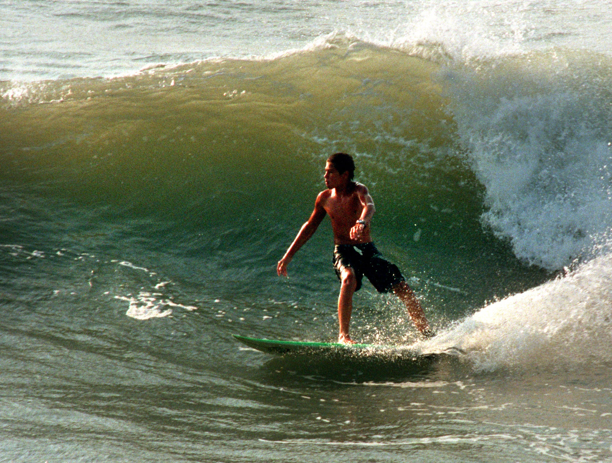 Matt Richter, 13, of Port Aransas, surfs at Horace Caldwell Pier in Port Aransas Tuesday, Oct. 5, 1999. Northeast winds and thunderstorms in the Gulf of Mexico created larger-than-usual waves on area beaches. High tides were attributed to the Gulf storms and the moon's pull on the Earth. The National Weather Service issued a coastal flood watch for today for beaches between Port O'Connor and Baffin Bay. A tropical depression in Bay of Campeche Tuesday could bring rain to the Coastal Bend Thursday, according to the National Weather Service. The depression was moving northwest Tuesday. The National Weather Service predicts the depression's winds will increase to 39 mph by Thursday, becoming Tropical Storm Irene.