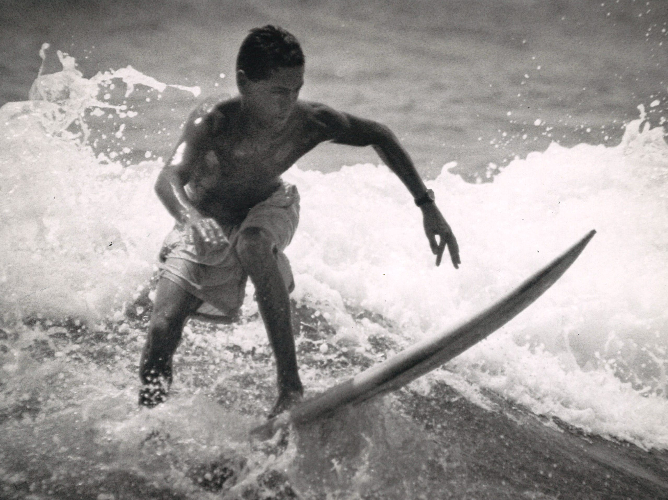 Ramiro Parron, 22, surfs at Mustang Island in Corpus Christi on May 7, 1992 before heading to work.
