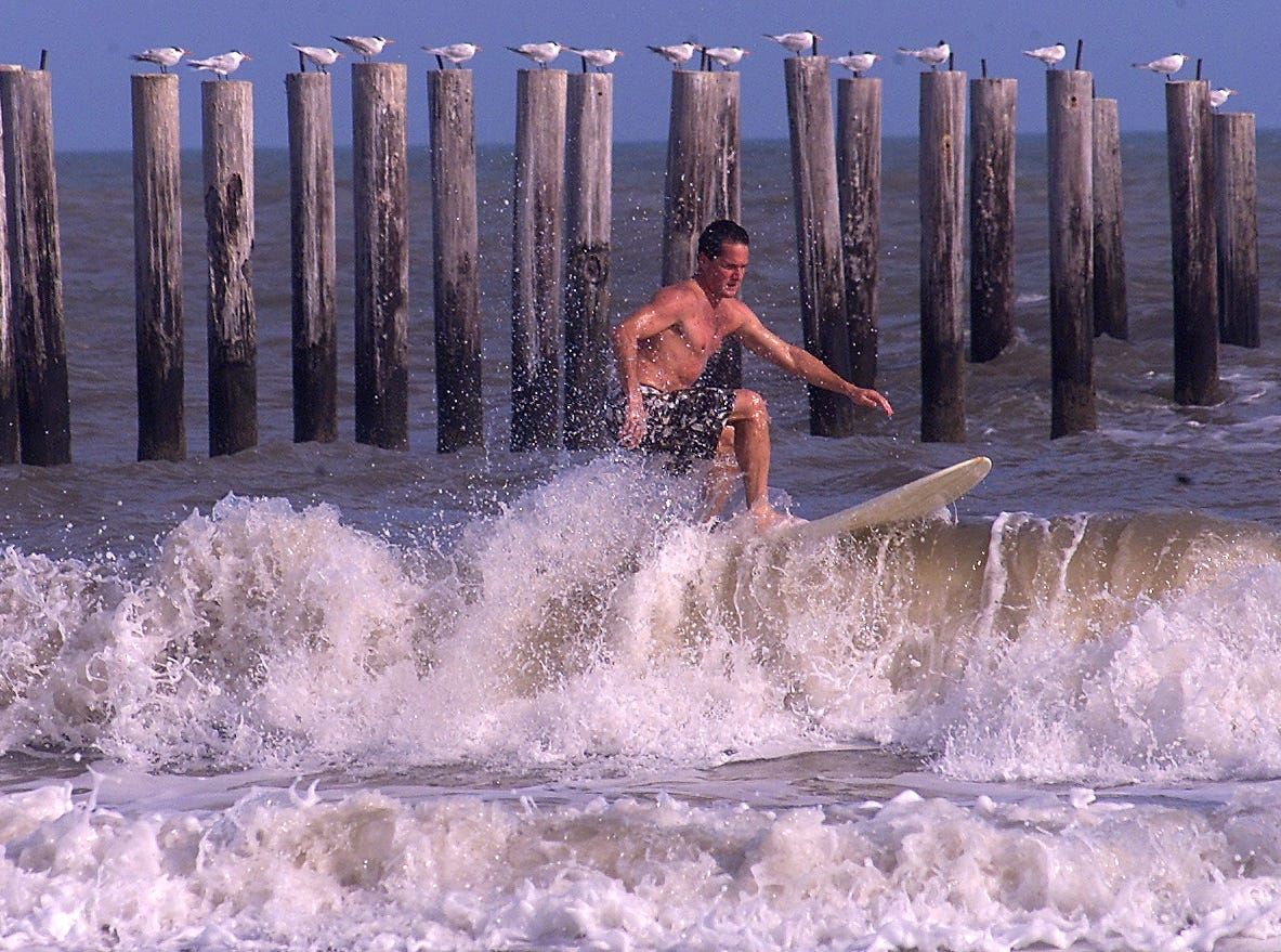 Steve Gentry tries to catch a wave Wednesday, Jan. 16, 2000 at J.P. Luby Surf Park. Corpus Christi set a record temperature for the second consecutive day Wednesday. The high was 87 degrees, beating 84 degrees, the record for that date in 1953, said National Weather Service Meteorologist Brian LaMarre. The weather service expects mostly sunny skies today with temperatures in the mid-70s, which is a little above the normal highs for this time of year. Lows tonight are expected to be in the upper 40s and lower 50s.