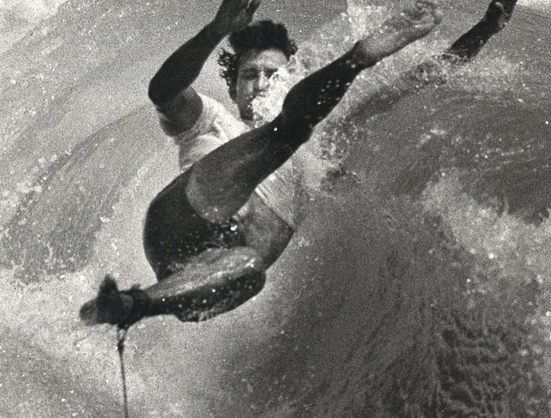 A surfer wipes out in August 1983 in Corpus Christi.