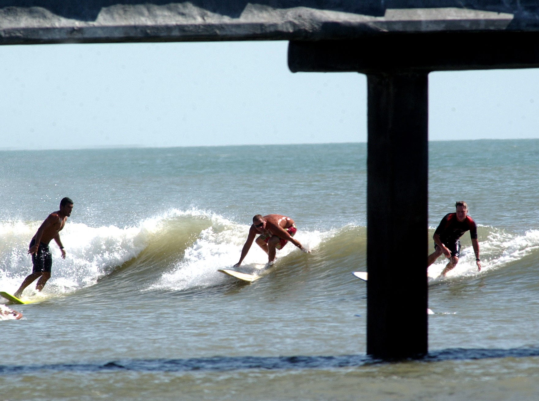 Surfers swarmed in and around Bob Hall Pier in Corpus Christi in the waves left over from Hurricane Rita on Saturday, Sept. 24, 2005.