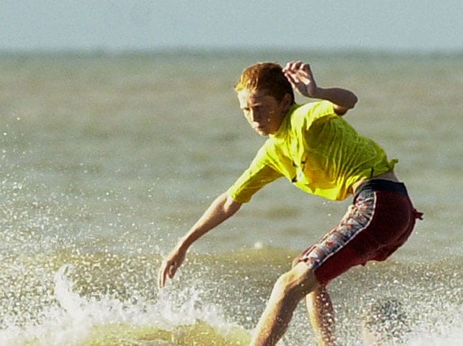 Corey Edler,13, of Rockport rides the nose during competition in the Pier Masters #2 Longboarding Contest at Horace Caldwell Pier in Port Aransas in June 2001.