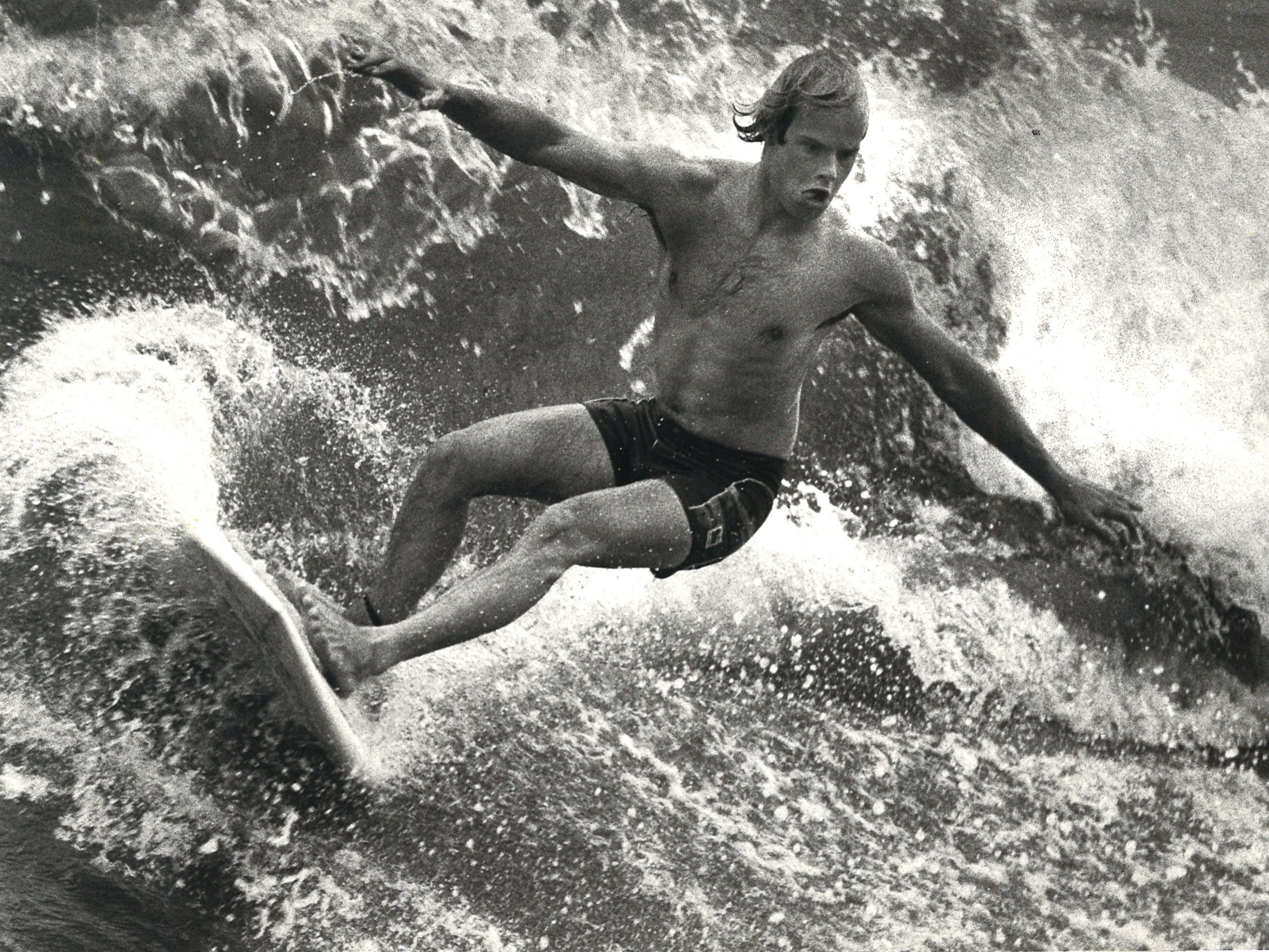 A surfer cuts back on a wave in Port Aransas on April 7, 1982.