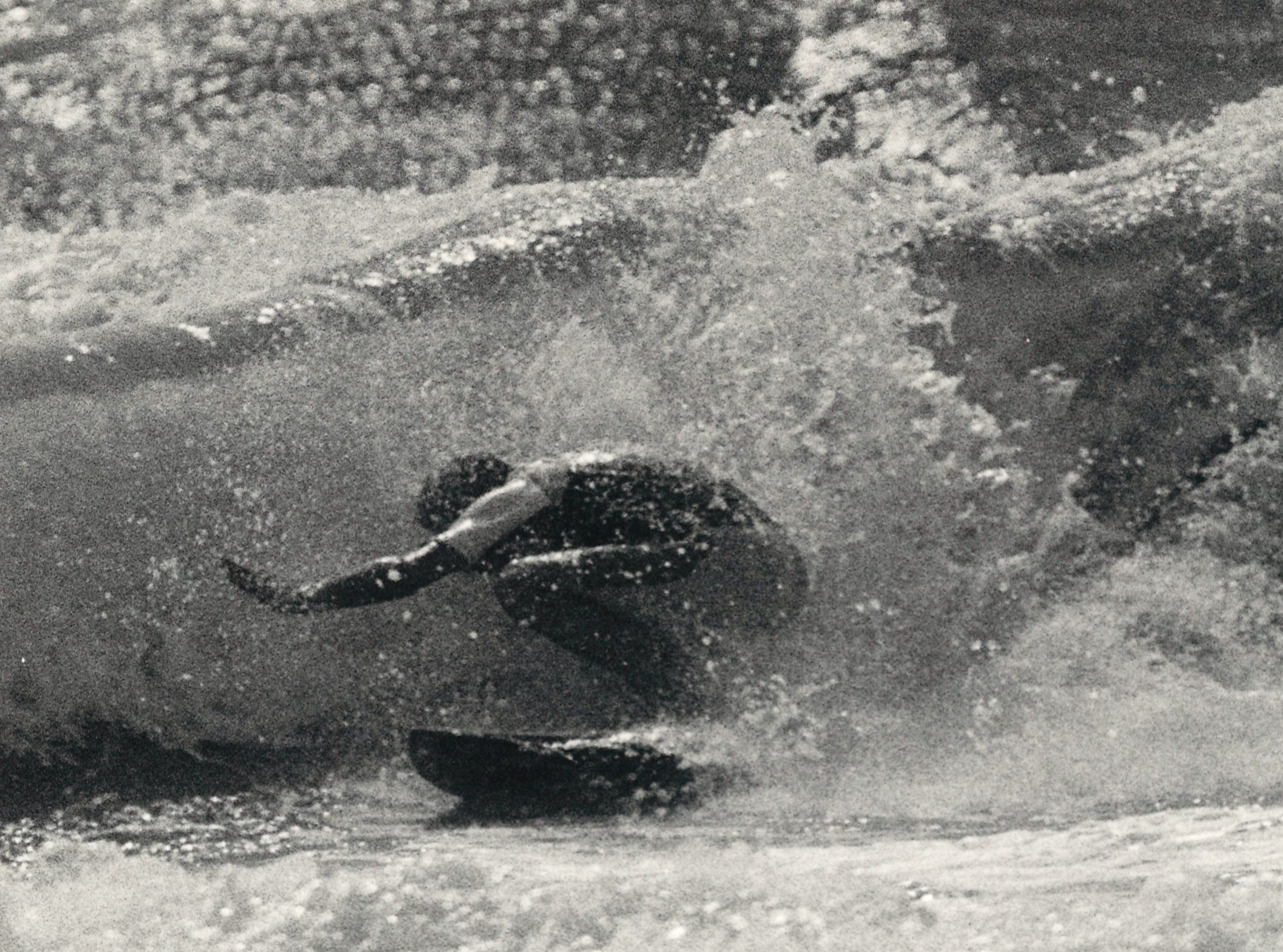 A surfer hits the waves during the Texas Pro/Am Surfing Classic at J.P. Luby Surf Park in Corpus Christi on April 4, 1985.