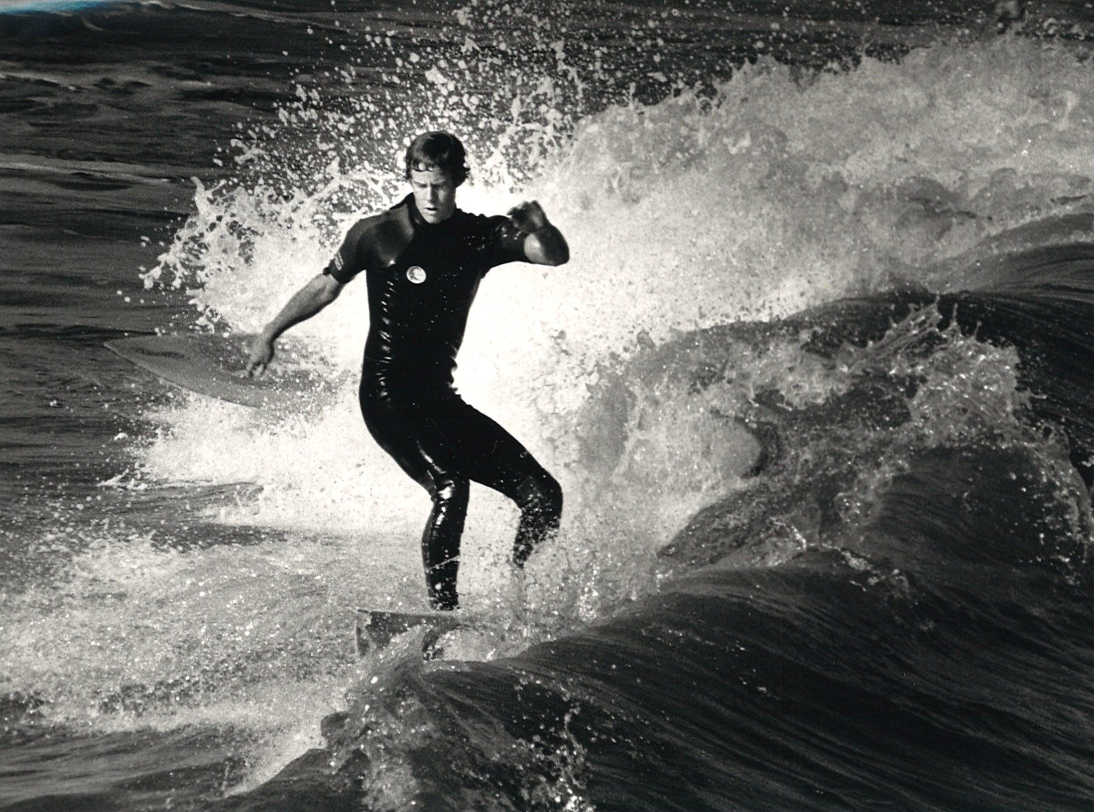 One of about 30 surfers who took to the surf north of Bob Hall Pier in Corpus Christi on Feb. 18, 1986.