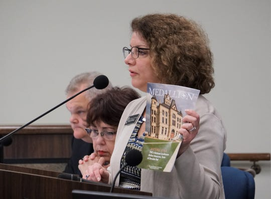 Sharon Fleming, with the Texas Historical Commission, speaks to Nueces County Commissioners on March 13, 2019.