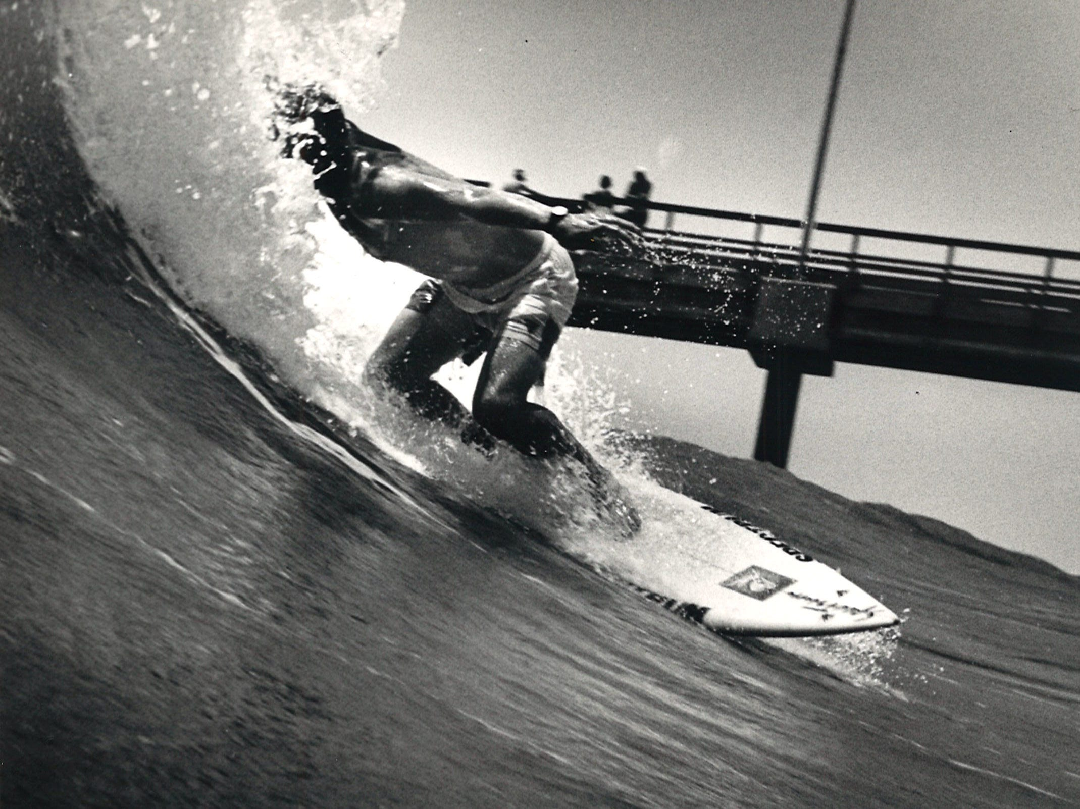 Mike Aldrich of Corpus Christi drops in on a wave next to Bob Hall Pier on May 30, 1987.
