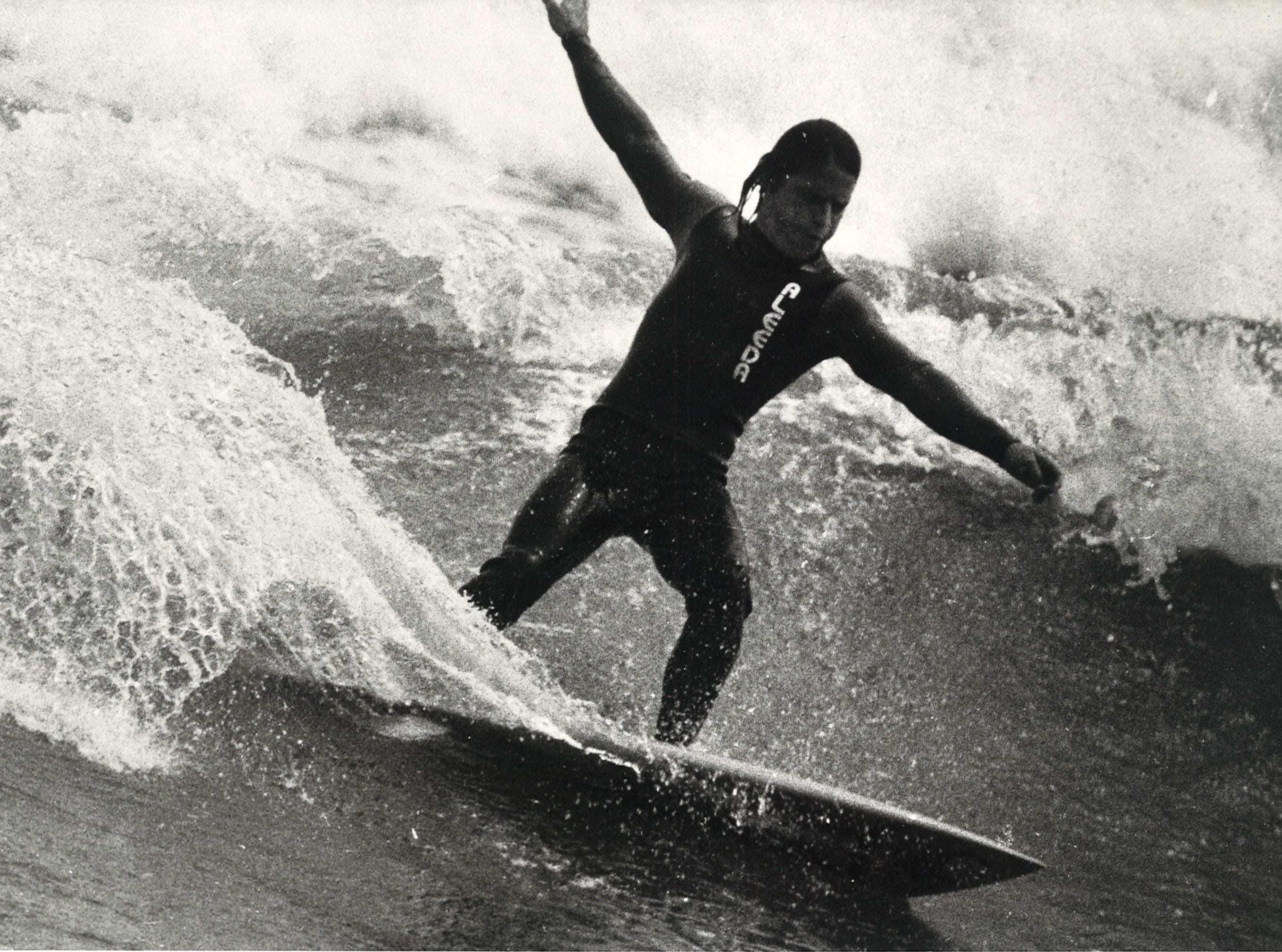 A surfer in Port Aransas on April 7, 1982.