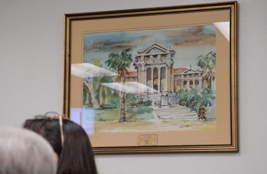 A painting of the 1914 Nueces County Courthouse hangs in the commissioners courtroom on March 13, 2019.