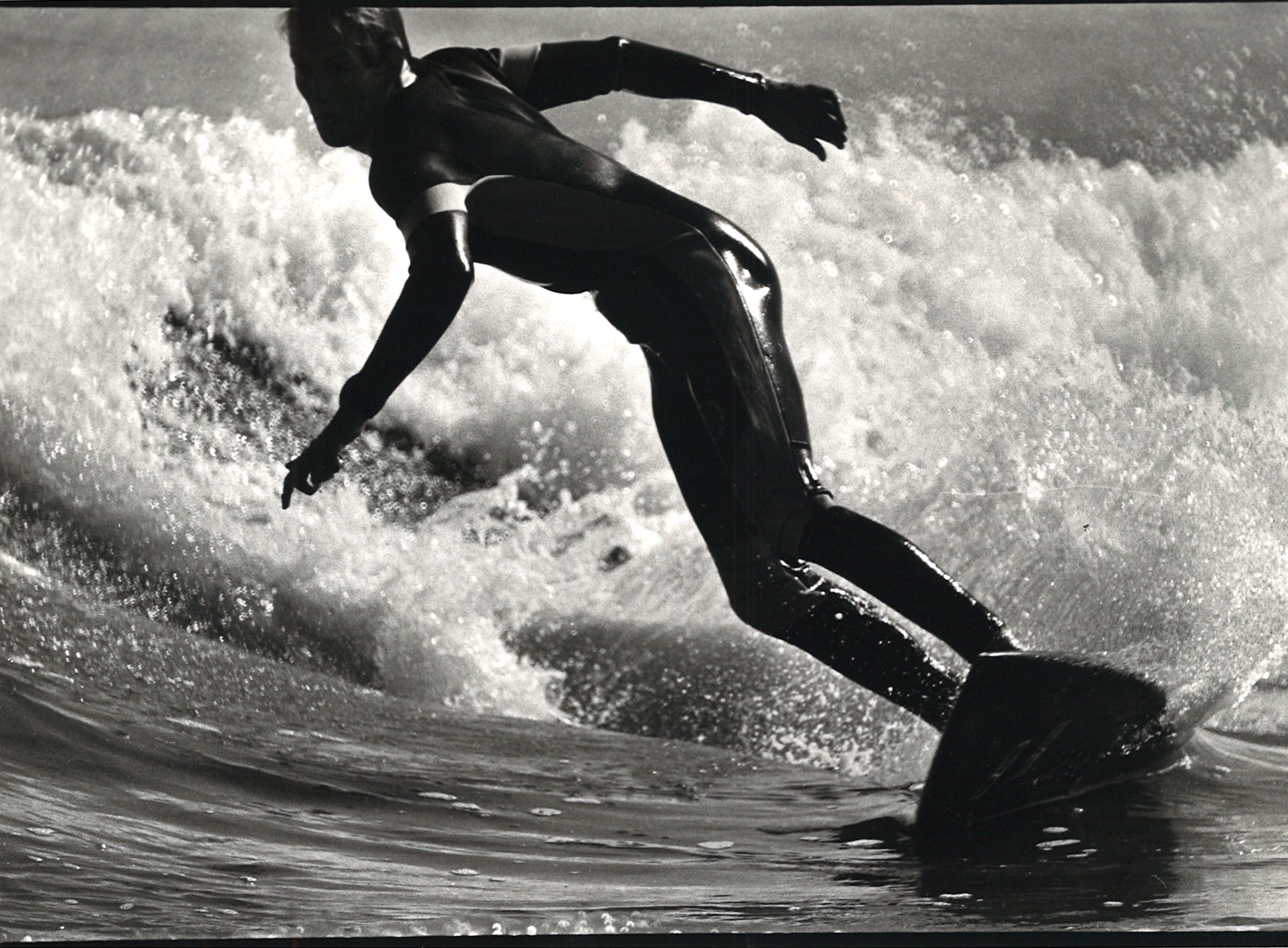 A surfer on Mustang Island in Corpus Christi in 1984.