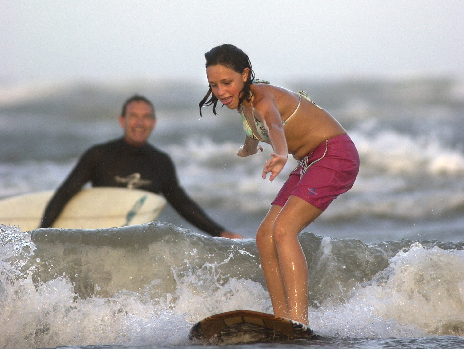 Michael Maley teaches daughter, Jasmin Maley, 11 to surf at Padre Island in Corpus Christi on June 13, 2003.
