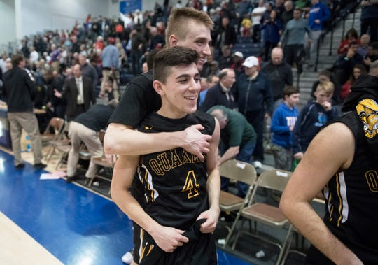 Moorestown's Jagger Zrada, front, celebrates with teammate Kevin Muhic after Moorestown defeated Haddonfield, 60-59, in a boys basketball Tournament of Champions quarterfinal game played at Toms River North High School on Wednesday, March 13, 2019.