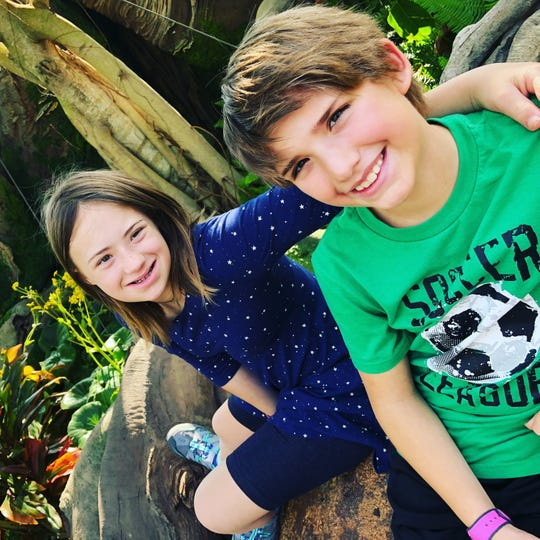 Zoe and Finn Sullivan enjoy time together during a trip to Disney World.