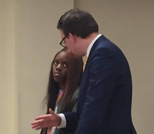 Quiasia Carroll of Gloucester City confers with public defender Eric Liszewski during a March 8 hearing in Superior Court, Camden.