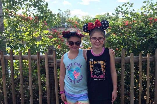 Lillian and Julia Mancini take a short break from the fun at Walt Disney World.